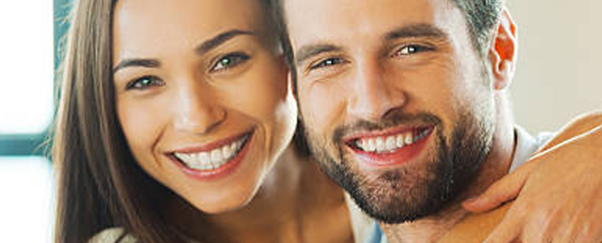 Man and woman smiling showing teeth