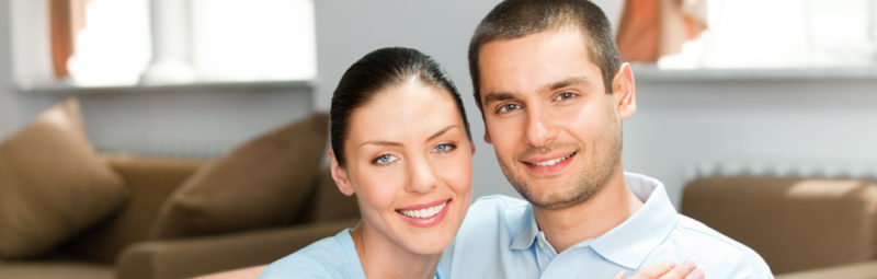 A couple showing teeth whitening
